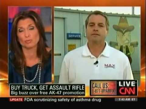 Car Dealer Giving Away Free AK-47's With New Trucks!