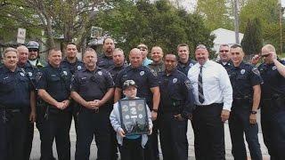 Boy Gets Surprise Police Escort Leaving Hospital After Battling Brain Tumor