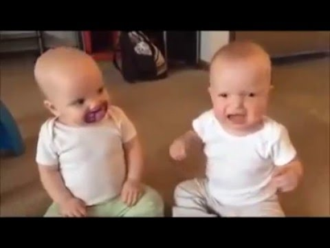 2 baby twins fight for one pacifier