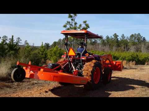 Mom and Dad driving the new family tractor Kubota L4701 2016