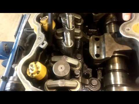 Removing and installing an EUI injector in a CAT 3406E