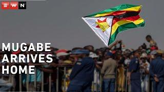 Mugabe arrives home