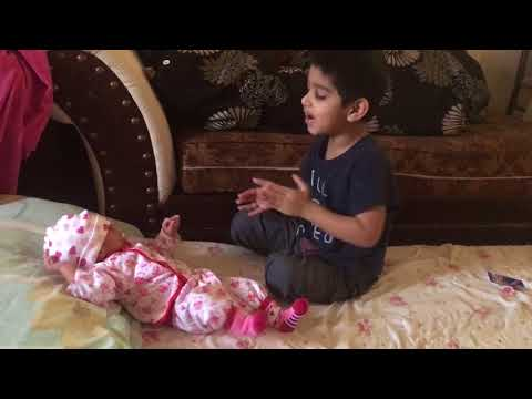 So cute. Brother trying to make the baby happy