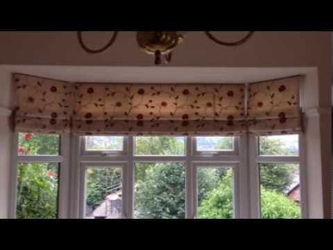 Roman and Roller blinds in a lounge area