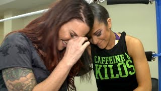 Lita tears up as she talks to Bayley prior to Women