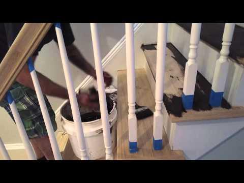 Richard applying Dark Walnut Stain inside stairs tread