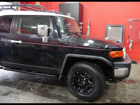 2007 TOYOTA FJ CRUISER WITH 17 INCH OFF ROAD RIMS & COOPER TIRES