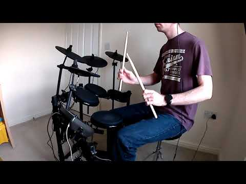 Danny learning to play Living on a Prayer on drums