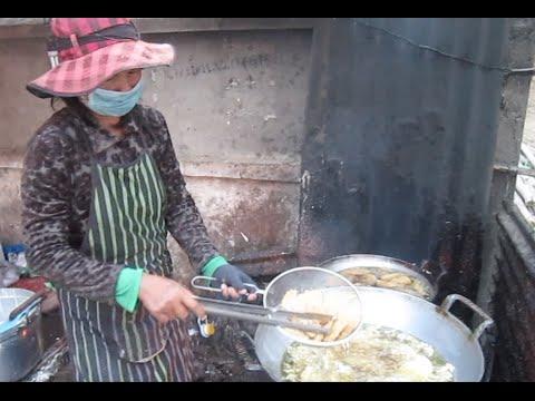 Cambodian Street food in New Phnom Penh frying banana & cassava
