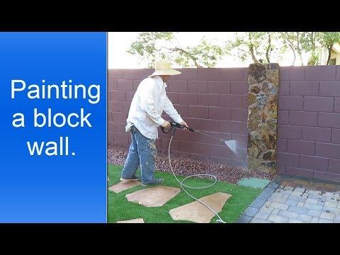Painting a block wall.