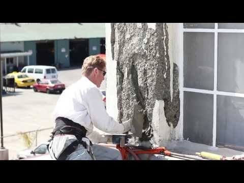 Repair spalling concrete with plaster or stucco