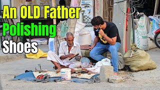An Old Father was Polishing shoes