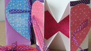 "¡SUSCRIBETE para más proyectos! http://bit.ly/PonteCrafty Caballete con palitos aquí http://bit.ly/1iSn4LN  Les dejo esta sencilla tarjeta (bastante conocida, pero que me gustó) para proximas ocasiones festivas. Está linda. Pueden decorarla usando papel deco de www.craftingeek.me  -------  • Cosas de mi vida: http://instagram.com/craftingeekliz# • Stalkeame en face http://www.facebook.com/craftingeek • Twitter: http://www.twitter.com/craftingeek • Plus: http://bit.ly/RJCxyG  -----  (I share you this easy heart card for festive moments. Is beautiful, you can decorate it with papel deco: http://bit.ly/DecoCG)  Música:  ""Turning Into Normal (What Once Felt Strange)""  by SackJo22 link: http://ccmixter.org/files/SackJo22/43036"