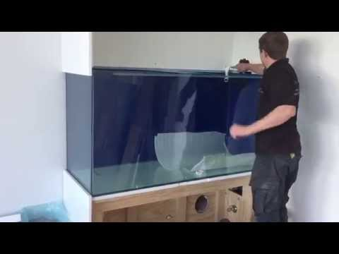 Installing an aquarium in the wall of a lovely water front house!
