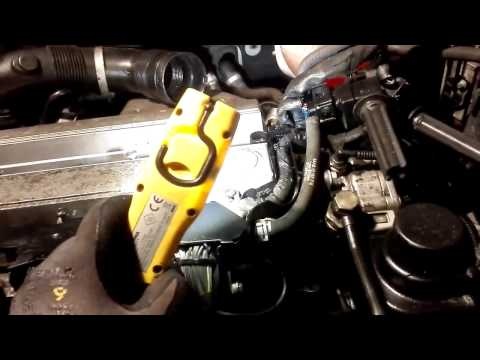 Using compressed air and diesel to clean oil sludge from engine