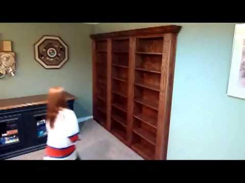 Hidden bookcase door to secret room
