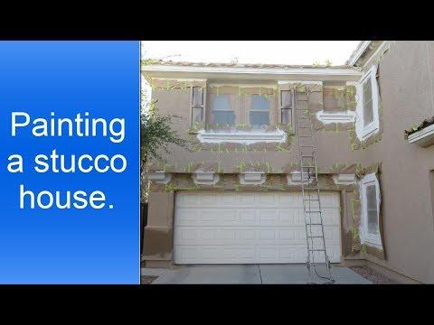 Painting a stucco house.