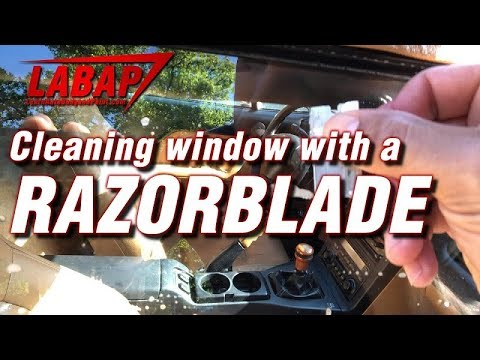 Cleaning window with a razor blade