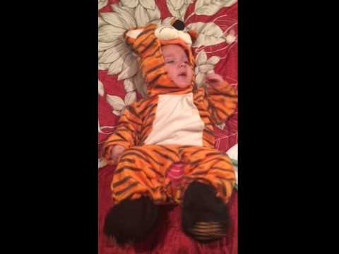 2 month old baby in tiger Halloween costume
