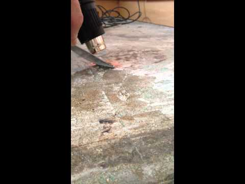 Removal of ceramic tile adhesive off a wooden floor