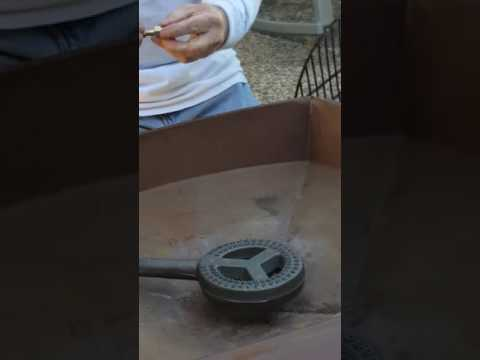 Changing a wood burning firepit into a propane firepit