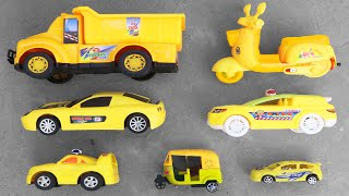Looking for some Yellow Toy Vehicles in a Rooftop - Indian Auto Rickshaw, Truck, Bike, Racing Cars