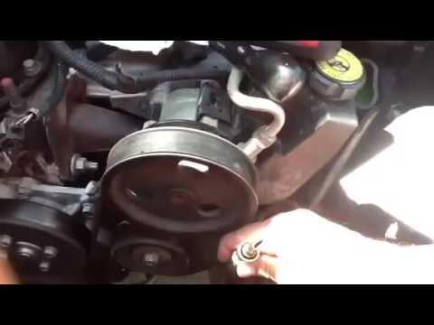 Removing transmission line from radiator of 2001 Jeep Cherokee