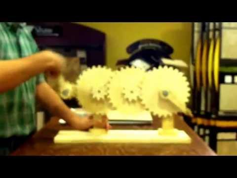 Compound gear train demonstration. 1:3:3:3 gear ratio.