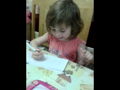 My little girl learning to write her name.