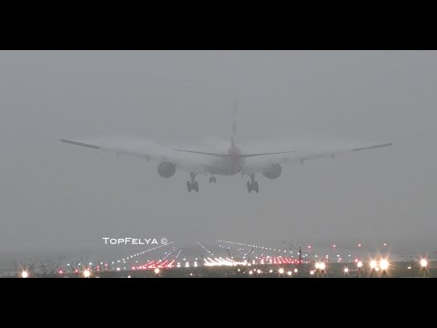 Airplanes landing in thick fog conditions and near-zero visibility at London Gatwick airport