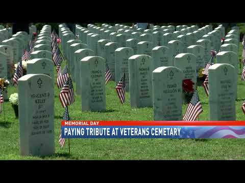 Paying tribute at veternas cemetary