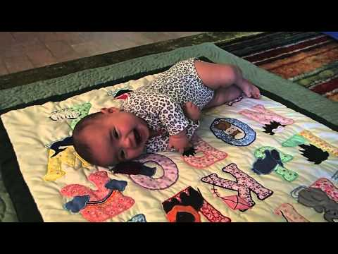 Baby Learning to Roll from Back to Stomach