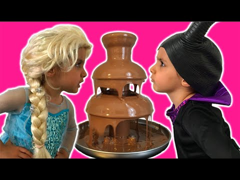 Elsa Vs Maleficent Real Life Disney Princess Movie + CHOCOLATE FOUNTAIN + Candy + 10 Surprise Eggs!