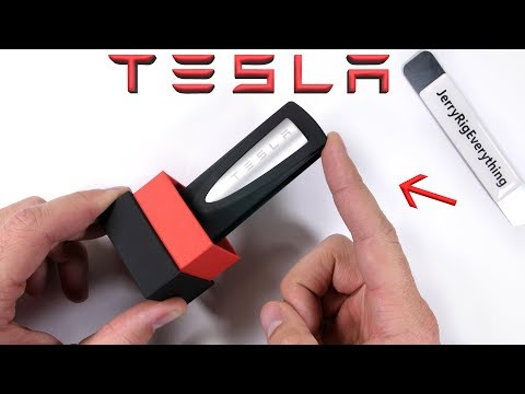 Tesla makes a PHONE CHARGER?! - Teardown