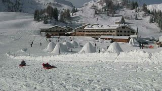 Igloo village built by migrants hands lifeline to dying Italian ski resort
