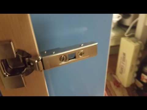 Installing Ikea Utrusta hinges on Sektion cabinet.