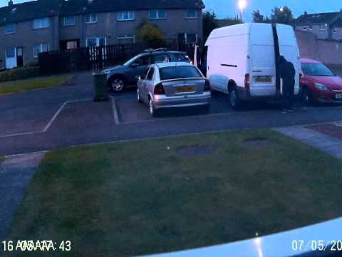 Thieves filmed while breaking into van