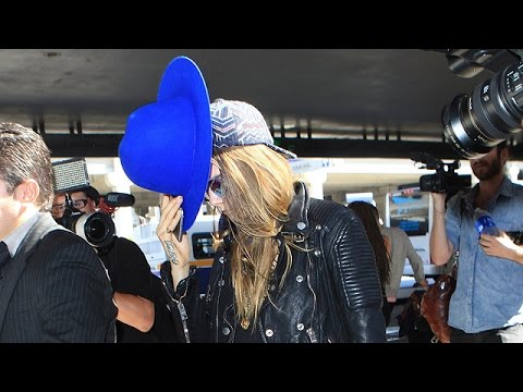 Cara Delevingne Tries To Keep Low-Profile At LAX With Eye-Catching Blue Hat