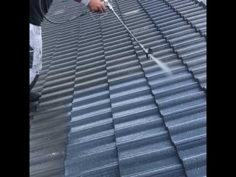 Painting concrete roof tiles.