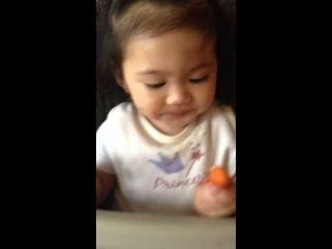 Baby eating steamed carrot