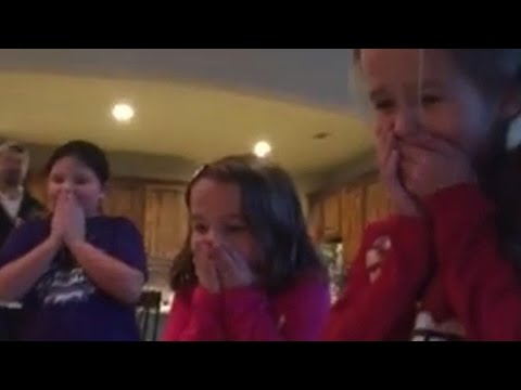 Texas parents surprise daughters with newly adopted brother