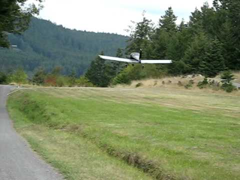 Carrie taking off at Center Island, Washington in RV-12.