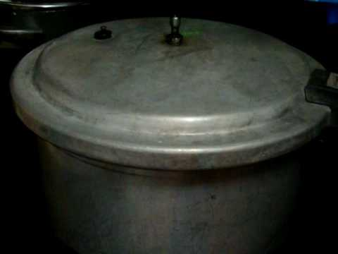 77 Showing a quick release on a pressure cooker