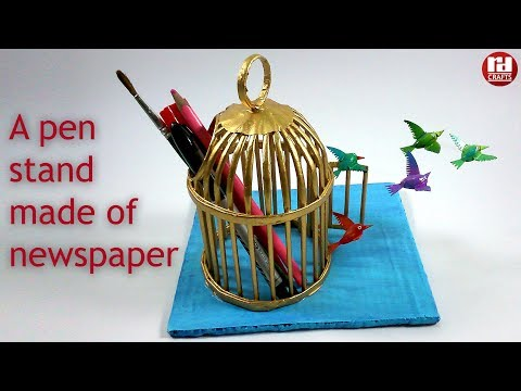 A newspaper cage as pen-stand based on freedom theme.