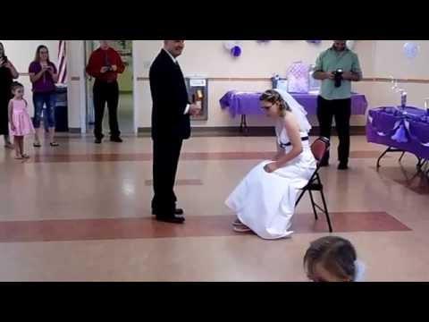 Tiffany & John's wedding. Garter belt & bouquet toss