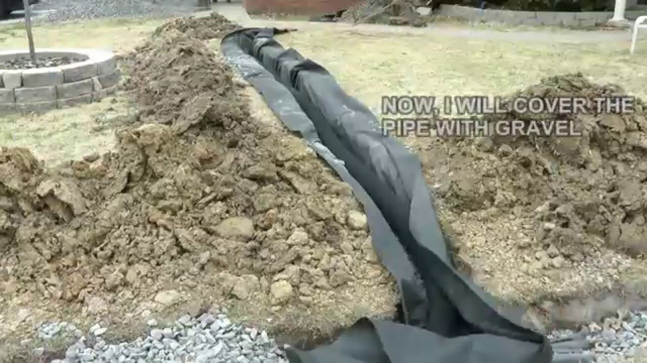 DIY How to build a French Drain.  How to drain surface water in your yard or property.