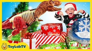 By Toylabtv Christmas For The Dinosaurs Opening Dinosaur Presents From Santa Jurassic World Surprise Toys