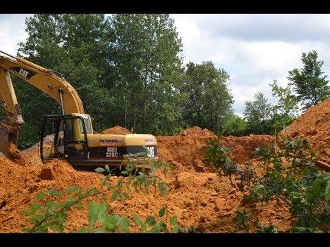 Building a log home part 2- Excavating