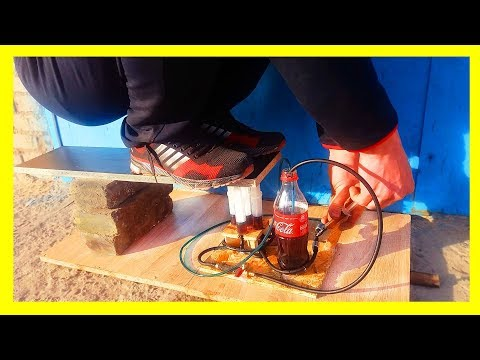 How to make a powerful hydraulic jack using Coca Cola and a syringe
