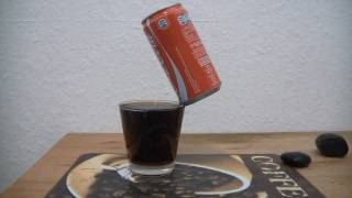Coke Can balancing on edge of a glass WOW